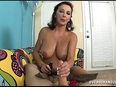 Topless Mature Lady Jerks A Dick
