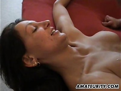 Amateur mom with big tits in action on her bed